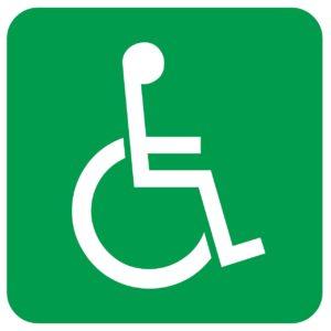 Rollstuhlsymbol; stilisierter Rollstuhl mit Rollstuhlfahrer*in, Weiß auf Grün
